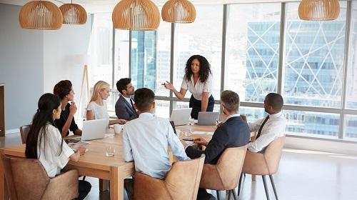 women heading board meeting